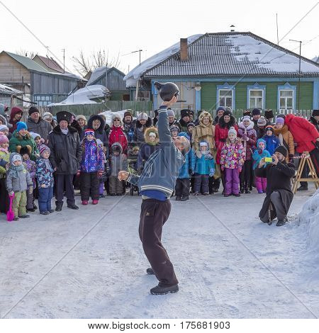 Berdsk Novosibirsk oblast Siberia Russia - February 26 2017: Russian holiday of farewell to winter. Submission - lifting exercises with weights