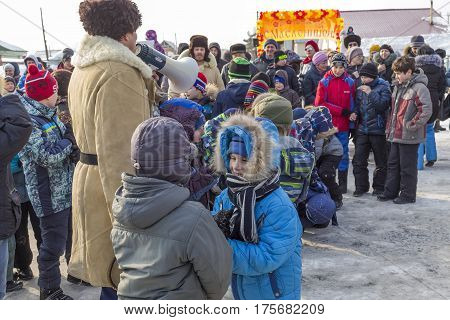 Berdsk Novosibirsk oblast Siberia Russia - February 26 2017: Russian holiday of farewell to winter. An old Russian fun - fight wall to wall. Power competitions of children