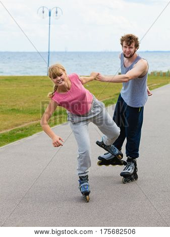 Woman Encourage Man To Do Rollerblading