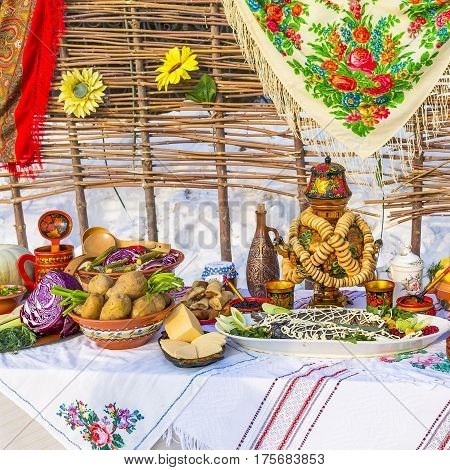 Berdsk Novosibirsk oblast Siberia Russia - February 26 2017: the table was laid with food on the street in the carnival holiday