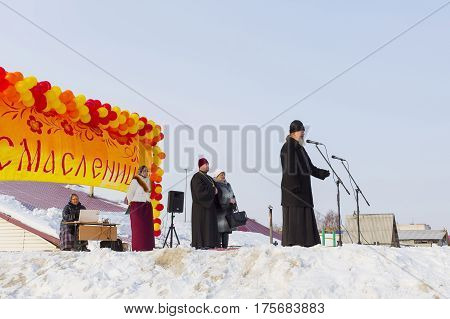 Berdsk Novosibirsk oblast Siberia Russia - February 26 2017: the Abbot Berd Candlemas parish father Vasily in a speech at the celebration of Maslenitsa