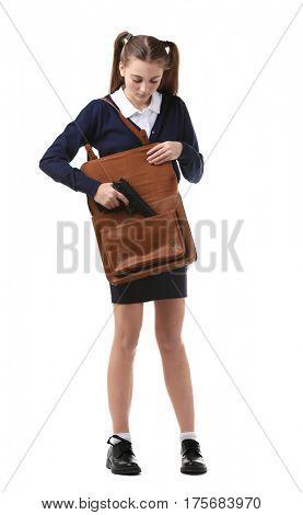 Teenage girl hiding gun in bag on white background