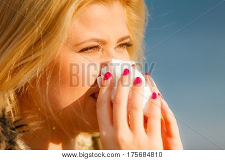 Sneezing Woman Into Handkerchief, Outside Sunny Shot