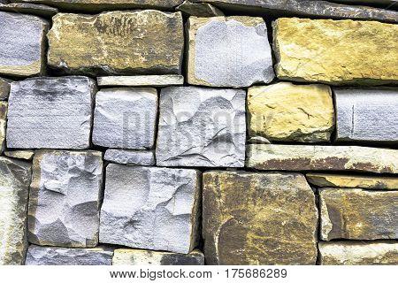 Textured background design of blocks of limestone