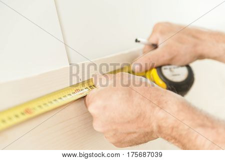 Woodworker Artisan In His Workshop Measuring