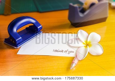 Text I Think Of You On Note Pad Or Memo Pad With Plumeria Or Frangipani Flower