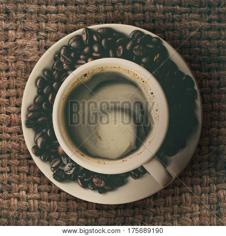 Top view of cup of coffee on dirty table