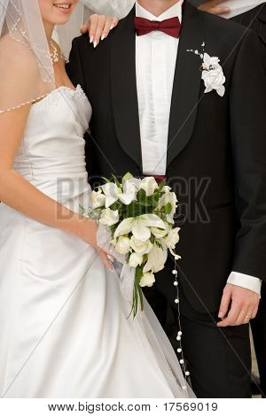 Young fashionable bride and groom