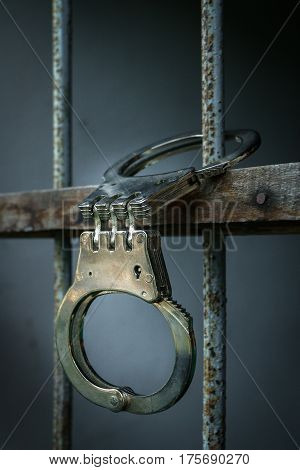 Close up hancuffs in prison for prisoner
