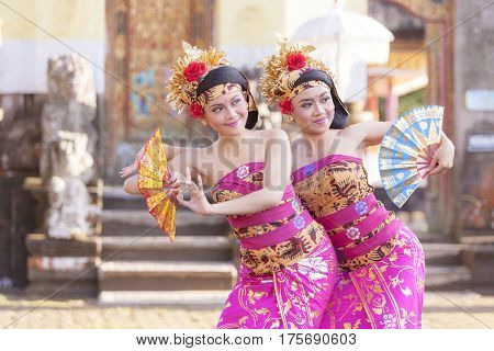 BALI - 6 March 2017 : girl performing traditional Indonesian dance at Ulun Danu temple Beratan Lake in Bali Indonesia on 6 March 2017 in Bali Indonesia.