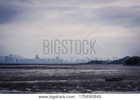 Wasteland next to a large city on an overcast day