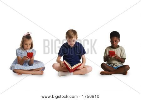 The young children of different races sitting together - two playing electronic games and the third reading a book. This image is one of a series of conceptual images isolated on white backgrounds. poster