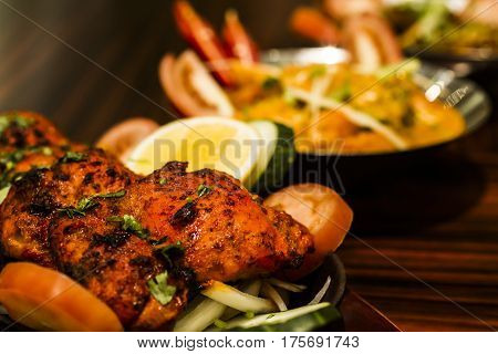 Traditional Indian dish of Tandoori Chicken with lemon