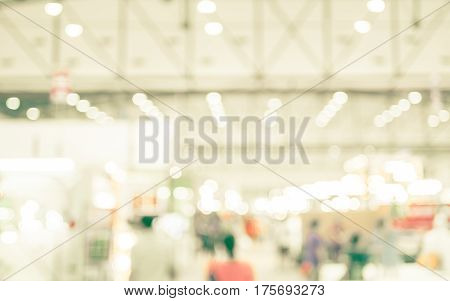 Blurred Background : Crowd Of People In Expo Fair With Bokeh Light