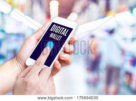 Hand Holding Mobile Phone With Digital Wallet Word With Blurred Supermarket Background,digital Marke