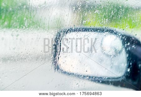 See Through Car Window To Side Rear-view Mirror In Raining Day