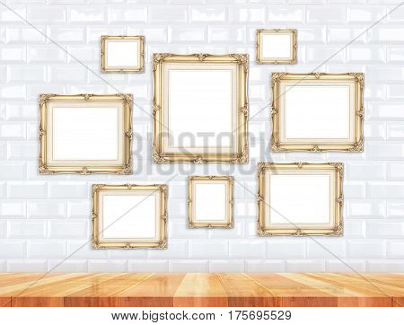 Group Of Golden Victorian Style Vintage Frames On White Tile Wall And Wood Floor,mock Up For Adding