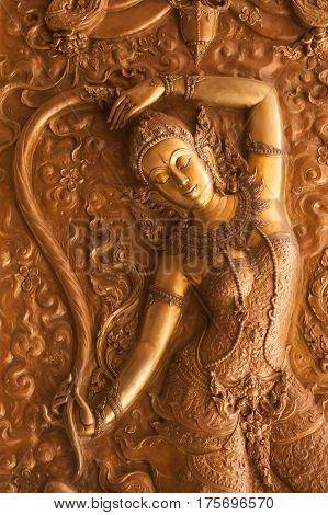 UDON THANI,THAILAND - JAN 25,2014: Image of detail at the base of the Angel on bronze in the Wihan of Wat Pa Phu Kon is located in the Udon Thani Province. The temple was built between 2010 and 2013.