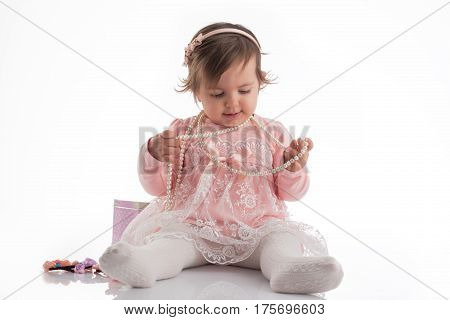Beautiful Little Baby Girl Playing With Necklace Portrait, Isolated
