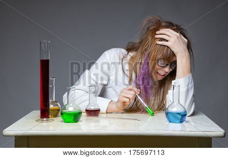 Problem and chemist with glass flask on gray background