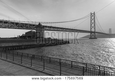 Black and White Akashi Kaikyo Bridge the longest suspension bridge over Kobe seaport Japan