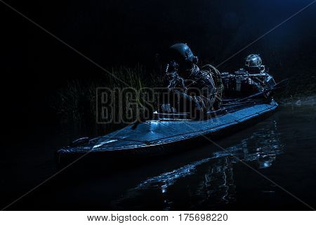 Two special forces soldiers in the military kayak. Diversionary mission under cover of darkness