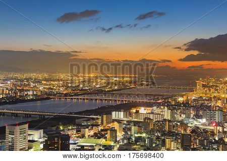 Sunset over Osaka city residence downtown from Umeda Sky building Japan