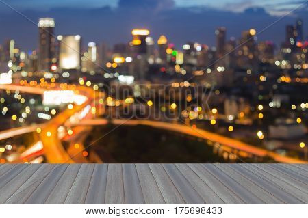 Opening wooden floor cityscape blurred ligh night view abstract background