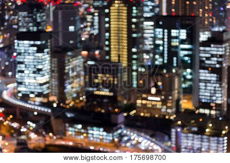 Blurred bokeh light Osaka office buiding aerial view abstract background