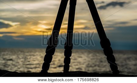 Tripod for photographer silhouette with sunset sky