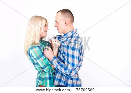 Man and woman playfully quarrel in the studio on a white background.