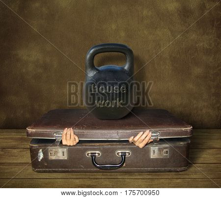 The woman is trying to get out of the old suitcase. But the big kettlebell is on this suitcase. It says