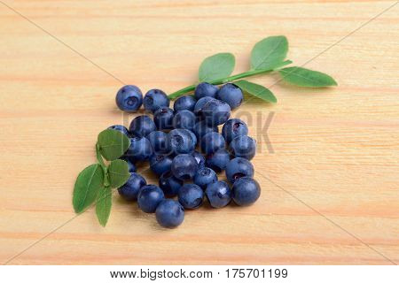 The fresh bilberries on wooden ground, view from above