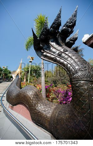 UDON THANI,THAILAND - JAN 25,2014: Image of Thai art of 7 heads Serpent on staircase to Chedi Prathom Rattanamahaburaphachan. The Chedi in Sri Lanka style,in Wat Pa Phu Kon of Na yung in Udon Thani Province,Thailand.