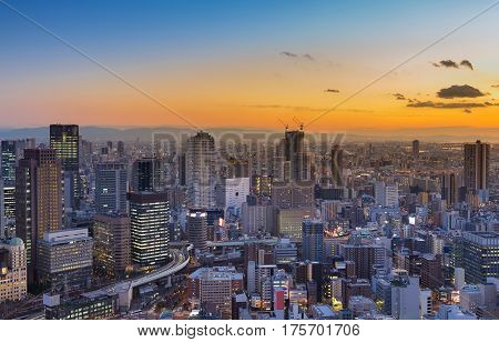 Aerial view Umeda city business downtown with sunset skyline background