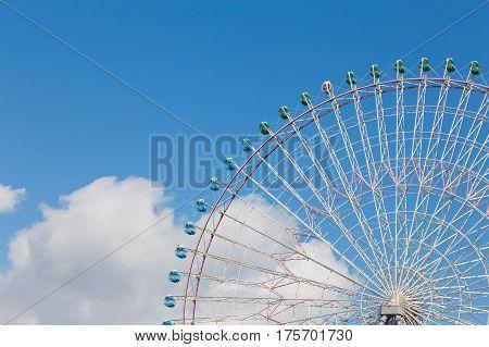 Ferris Wheel against blue sky background amusement park