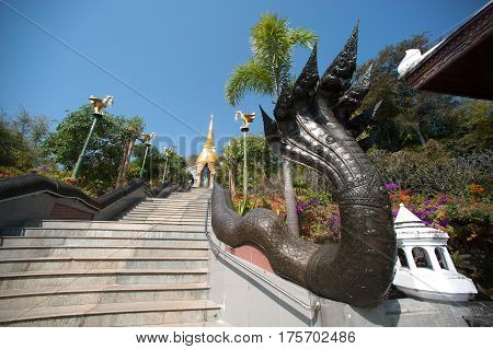 UDON THANI,THAILAND - JAN 25,2014: Image of Thai art of 7 heads Serpent on staircase to Chedi Prathom Rattanamahaburaphachan.The Chedi in Sri Lanka style,in Wat Pa Phu Kon of Na yung in Udon Thani Province,Thailand.