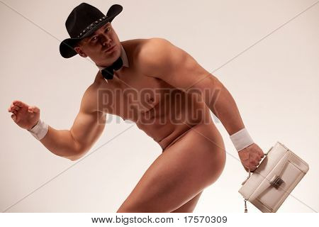 Muscular naked male stripper with ladie's purse