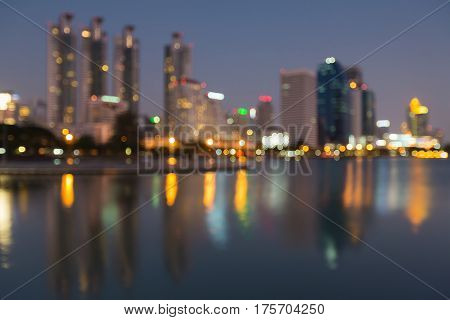 Abstract blurred bokeh light city office building with reflection night view abstract background