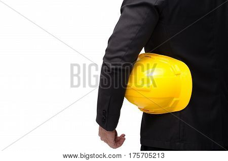 back view of smart businessman in formal suit and holding yellow safety helmet isolated on white background.