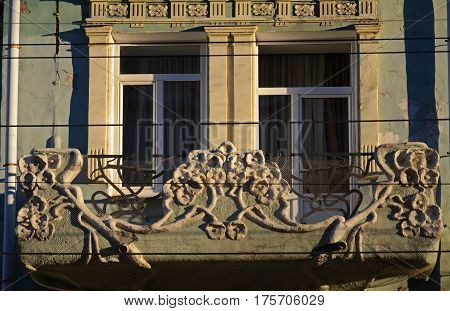 The part of facade of an old residential building on pedastrian street of Samara city