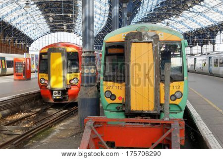 BRIGHTON GREAT BRITAIN - FEB 24 2017: Two trains in the beautiful old train station in Brighton UK. February 24 2017 in Brighton Great Britain