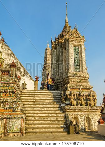 BANGKOK, THAILAND - JANUARY 18, 2014: Visitors in the ancient buddist Wat Arun Temple or Temple of Dawn. Bangkok, Thailand