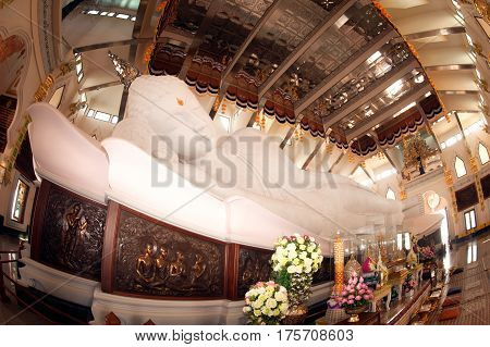 UDON THANI,THAILAND-JANUARY 25,2014 : The 20-meter long reclining Buddha, which is made from 43 blocks of exquisite Italian Carrara Marble, in Wat Pa Phu Kon of, Ban Na Kham, Ban Kong sub-district , Na yung District in Udon Thani Province, Thailand.