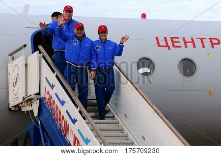 BAIKONUR, KAZAKHSTAN - NOVEMBER 11, 2014: ISS Expedition 42/43 crewmembers T.Virts (left), A.Shkaplerov (center), S.Cristoforetti (right) arrive in Baikonur cosmodrome to fly to ISS