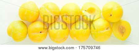 Yellow plum is isolated on the white background, cope space
