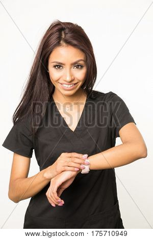 Woman in medical or beauty career using smart watch  touchscreen technology to recieve information