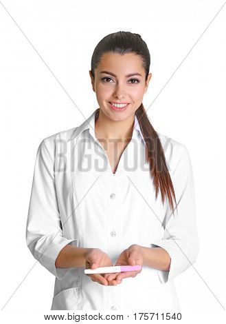 Beautiful doctor holding pregnancy test on white background