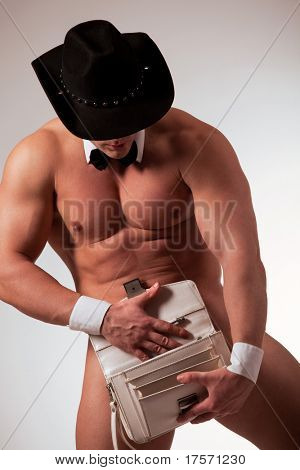 Muscular naked male stripper with purse