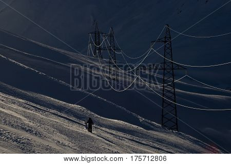 Power supply line in winter evening. Georgia mountains